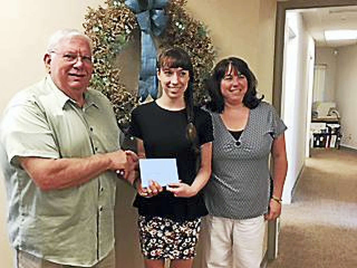Congratulations to the 2017 Torrington Municipal & Teachers FCU scholarship winners. Mariah Hilpert, a graduate of Lewis Mills High School and Lauren Canfield, a graduate of Torrington High School. Each graduate received a $1000.00 scholarship presented by board president Joe Manes. The scholarship was established in 1986 and is given annually to two graduating seniors who are TMTFCU members in good standing.