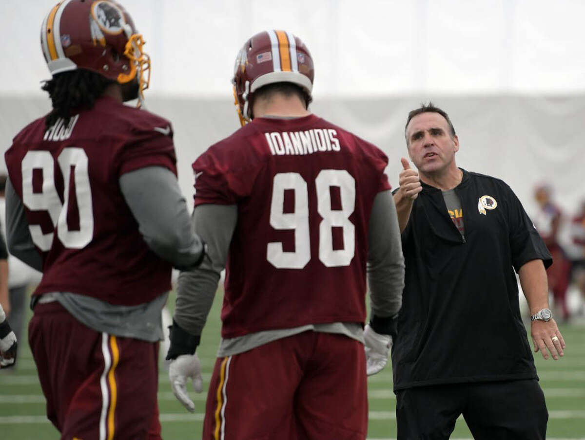 Washington Redskins coach Jim Tomsula instructs his players during OTAs.