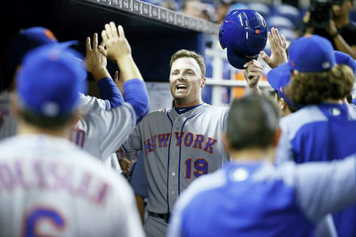 The Mets' Jay Bruce celebrates after scoring on a double by T.J. Rivera in the first inning against the Marlins on Thursday.