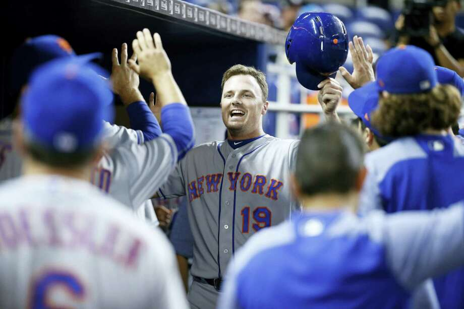 The Mets' Jay Bruce celebrates after scoring on a double by T.J. Rivera in the first inning against the Marlins on Thursday. Photo: Wilfredo Lee — The Associated Press  / Copyright 2017 The Associated Press. All rights reserved.