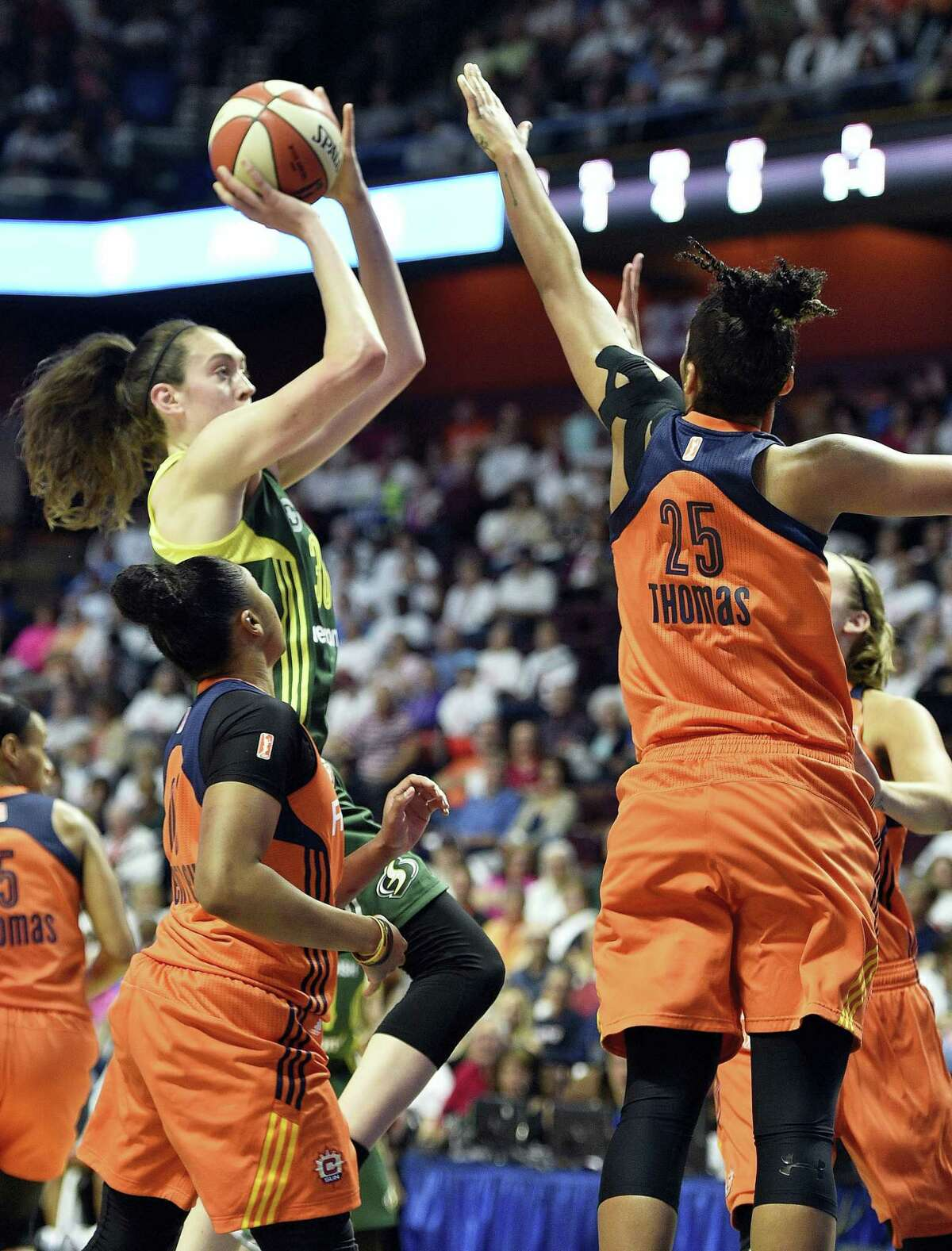 The Storm's Breanna Stewart shoots over the Sun's Alyssa Thomas during Thursdays' game in Uncasville.