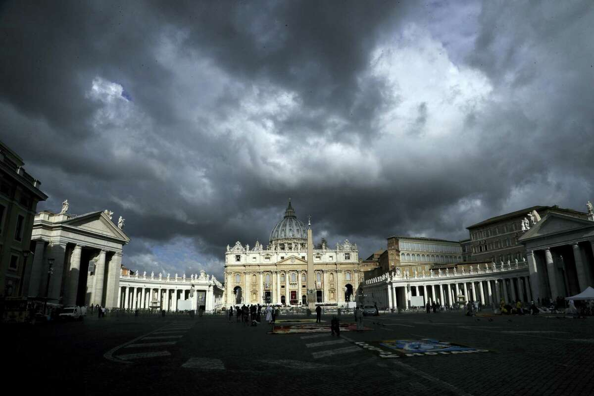 Clouds hang over St. Peter's Basilica, at the Vatican on June 29, 2017. The Catholic Archdiocese of Sydney says Vatican Cardinal George Pell will return to Australia to fight sexual assault charges as soon as possible.