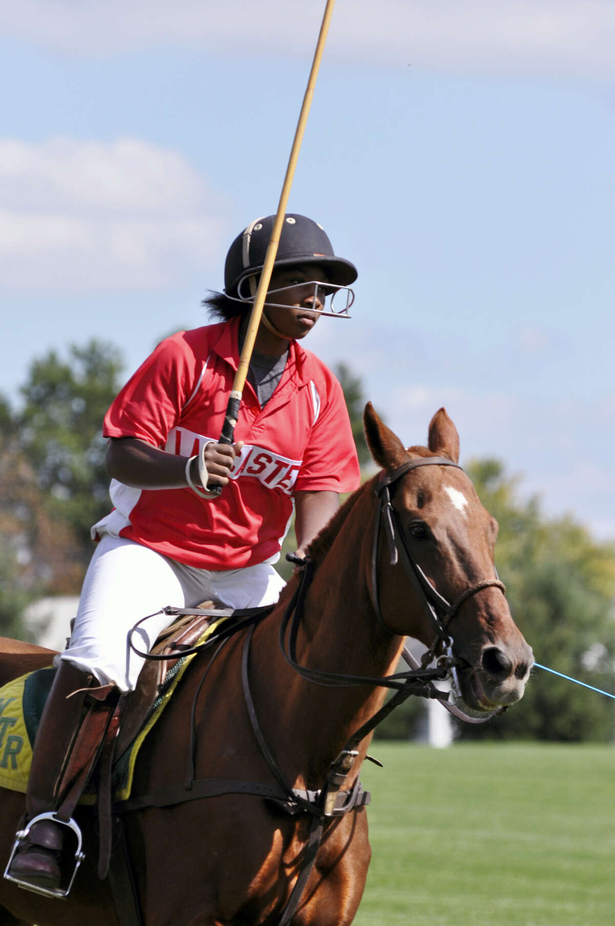 This undated photo provided by the Work to Ride program shows 19-year-old Shariah Harris playing polo at the Polo Club in Lancaster, Pa. Harris, who grew up in single-parent home just outside of west Philadelphia, is set to become the first African American woman to play in a top-tier U.S. polo event when she mounts up Friday, June 30, 2017, for the Postage Stamp Farm polo team in the Silver Cup at the tony Greenwich Polo Club in Connecticut.