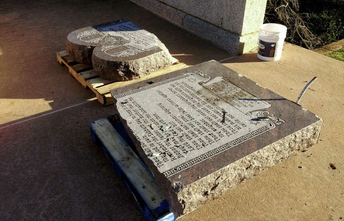 In this Oct. 24, 2014, file photo, the damaged remains of a Ten Commandments monument lie on the state Capitol grounds in Oklahoma City after driver, Michael Tate Reed of Van Buren, Ark., crashed into the statue. Tate was admitted to a hospital for mental treatment. Formal charges were never filed. On Wednesday, June 28, 2017, Reed was booked into jail in Little Rock on preliminary charges in connection with driving a vehicle into the newly installed Ten Commandments monument on the grounds of the state Capitol in Little Rock.