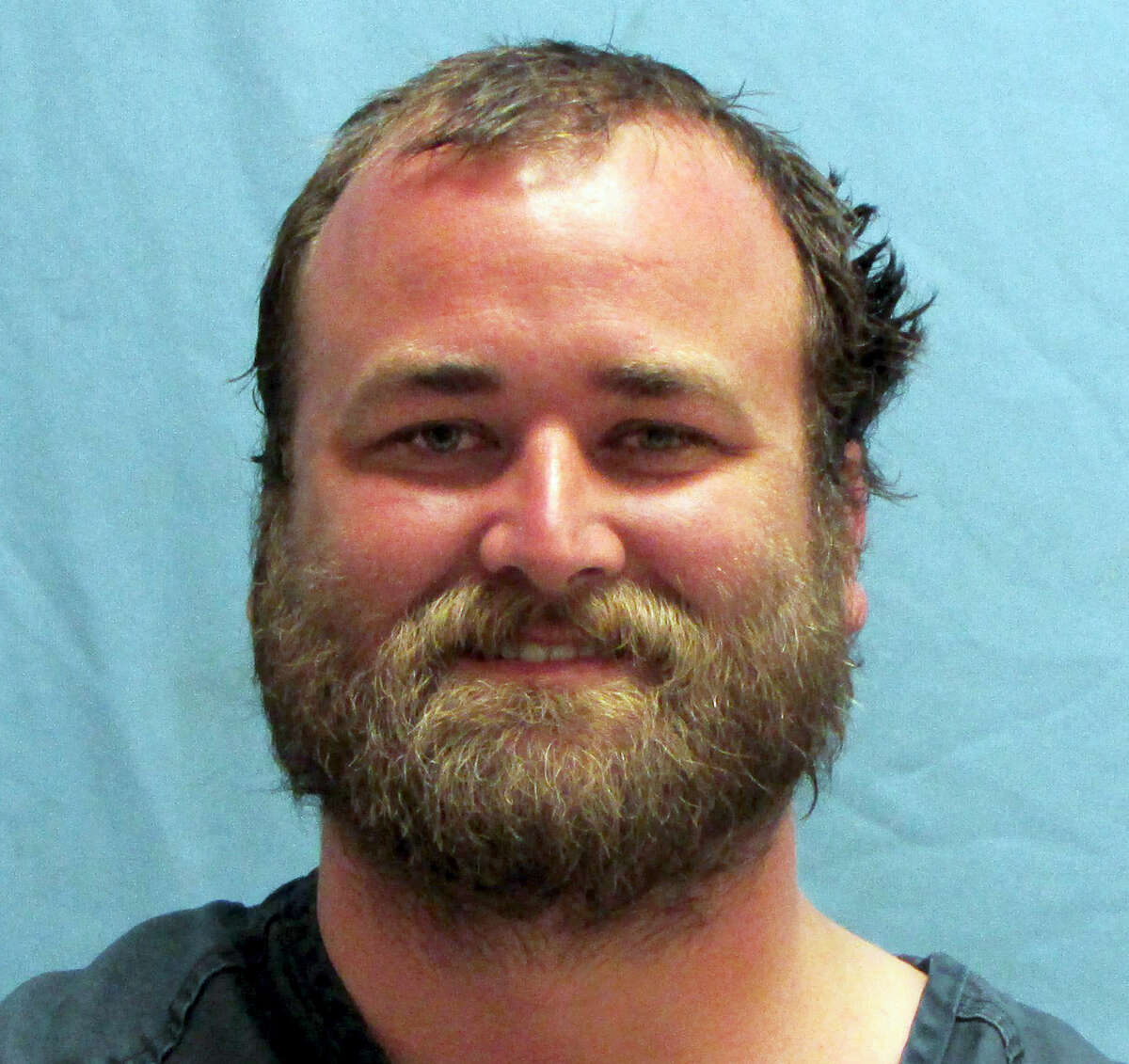 This photo provided by the Pulaski County Sheriff's Office in Little Rock, Ark., shows Michael Tate Reed, of Van Buren, Ark., who was booked into the jail Wednesday morning, June 28, 2017, on preliminary charges of defacing objects of public interest, criminal trespass and first-degree criminal mischief. He is accused driving a vehicle into Arkansas' new Ten Commandments monument on the state Capitol grounds in Little Rock.