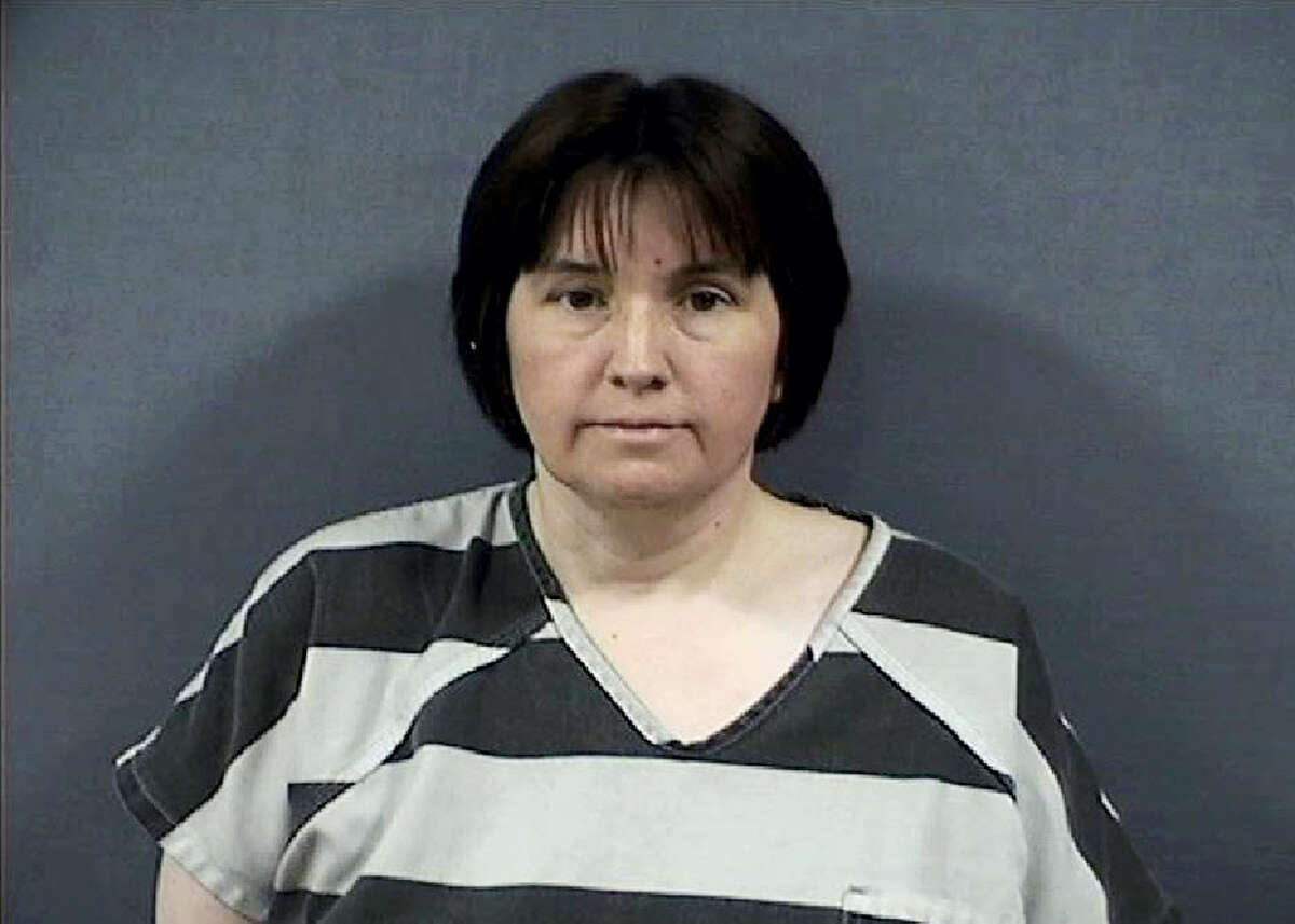 This undated photo released by the Monroe County Sheriffs Office shows Sherri Richter. Richter is accused of trying to torch a car with her 11-year-old son bound and locked inside at a southeast Michigan cemetery. The Monroe County sheriff's office said 48-year-old Richter was arraigned Thursday, June 29, 2017, on assault with intent to murder and arson charges.