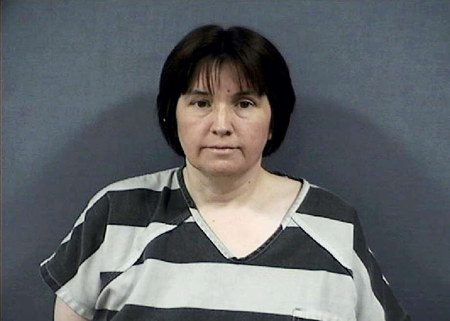 This undated photo released by the Monroe County Sheriffs Office shows Sherri Richter. Richter is accused of trying to torch a car with her 11-year-old son bound and locked inside at a southeast Michigan cemetery. The Monroe County sheriff's office said 48-year-old Richter was arraigned Thursday, June 29, 2017, on assault with intent to murder and arson charges. Photo: Monroe County Sheriffs Office Via AP   / Monroe County Sheriff's Department