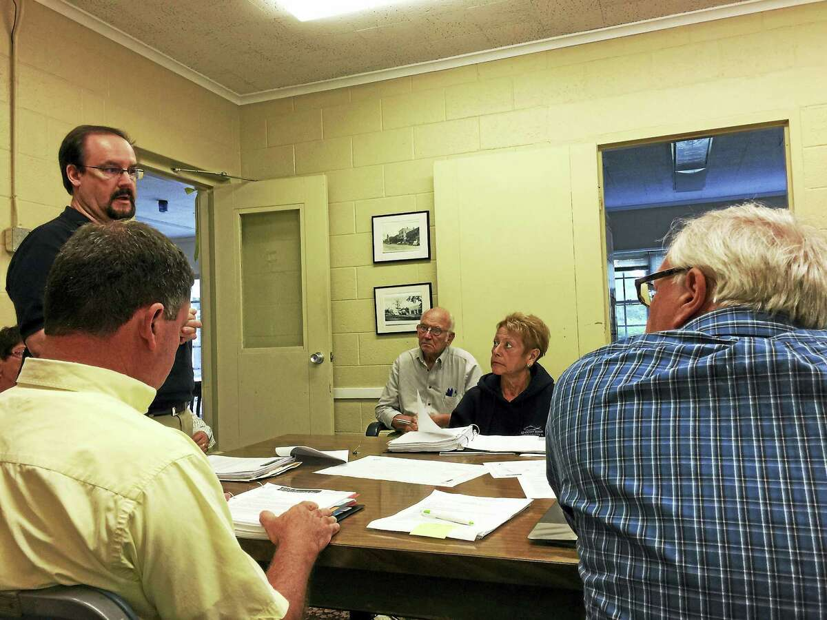 Jeff Duigou of Eagle Environmental Inc. presents the results of a Phase I environmental assessment of the Bantam Annex property to the Litchfield Board of Selectmen Tuesday.