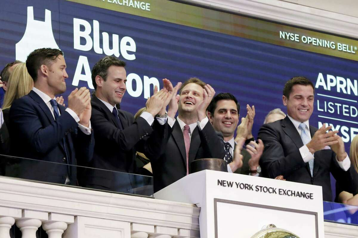 Blue Apron CEO Matt Salzberg, center, joins applause with fellow company co-founders Matt Wadiak, second left, and Ilia Papas, second from right, during opening bell ceremonies of the New York Stock Exchange before their IPO begins trading, Thursday, June 29, 2017. NYSE President Tom Farley is at right.