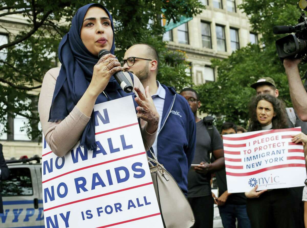 Yemeni American Wadid Hassan speaks to supporters who gathered to protest a travel ban in Union Square, Thursday, June 29, 2017, in New York. A scaled-back version of President Donald Trump's travel ban takes effect Thursday evening, stripped of provisions that brought protests and chaos at airports worldwide in January yet still likely to generate a new round of court fights.