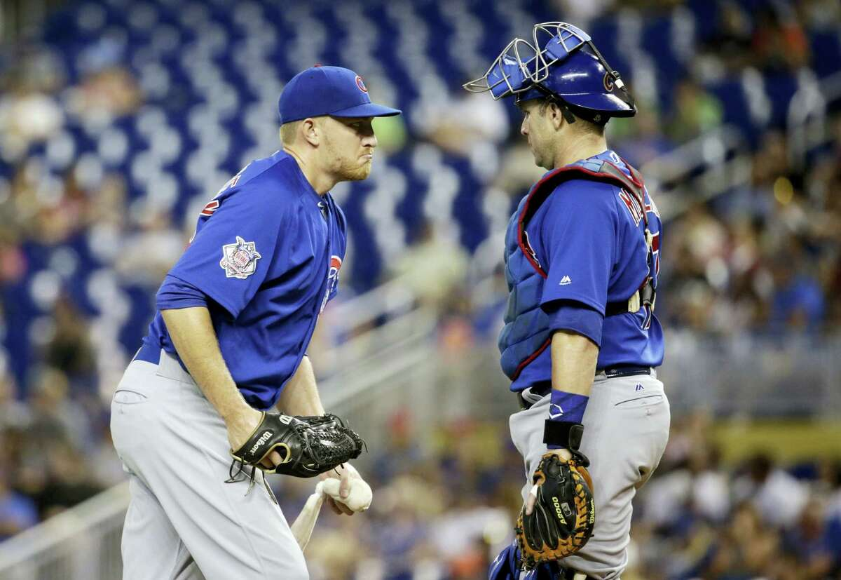 Chicago Cubs starting pitcher Mike Montgomery, left, talks with catcher Miguel Montero during the first inning of a baseball game against the Miami Marlins on June 25, 2017 in Miami.