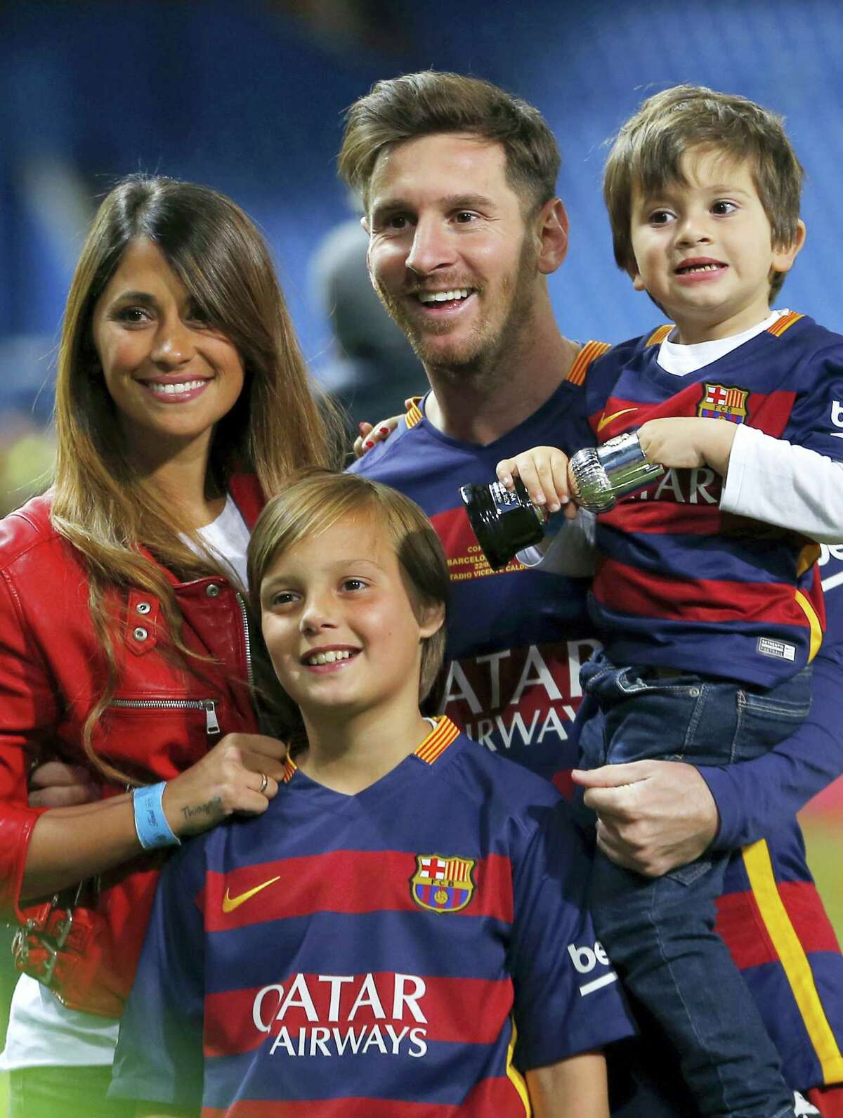Barcelona's Lionel Messi, carrying his son, will be marrying 29-year-old Antonella Roccuzzo, his childhood friend and mother of his two children.