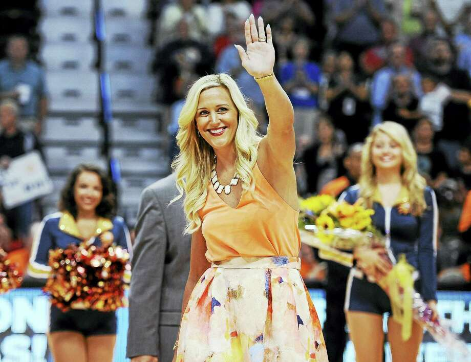 Former Connecticut Sun player Katie Douglas waves as she is honored before a game against the Liberty in 2015 in Uncasville. Photo: The Associated Press File Photo  / FR125654 AP