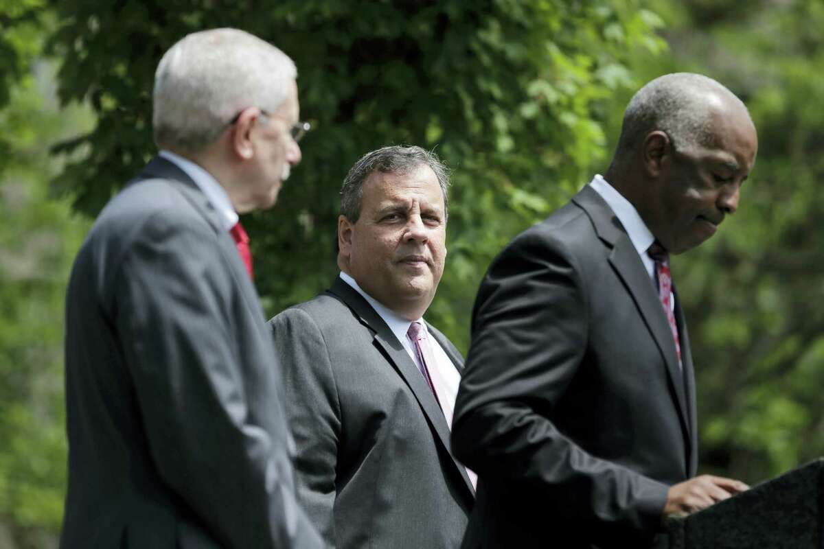 New Jersey Gov. Chris Christie, center, waits to speak during a news conference in Trenton, N.J., on Tuesday. The Supreme Court agreed Tuesday to take up New Jersey's bid to allow sports betting at its casinos and racetracks, a case that could lead other states to seek a share of the lucrative market.
