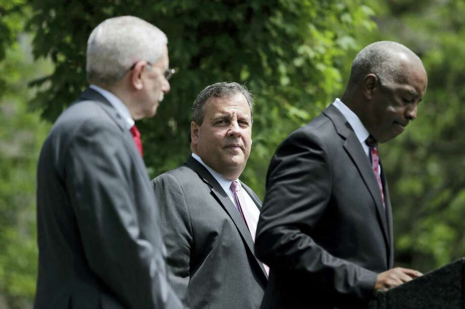 New Jersey Gov. Chris Christie, center, waits to speak during a news conference in Trenton, N.J., on Tuesday. The Supreme Court agreed Tuesday to take up New Jersey's bid to allow sports betting at its casinos and racetracks, a case that could lead other states to seek a share of the lucrative market. Photo: Seth Wenig — The Associated Press  / Copyright 2017 The Associated Press. All rights reserved.