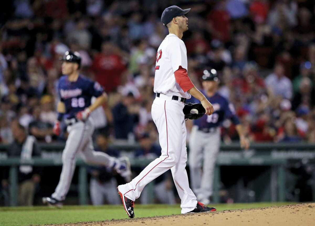 Red Sox starting pitcher Rick Porcello walks back to the mound as the Twins' Max Kepler rounds the bases on his two-run home run during the sixth inning Wednesday.