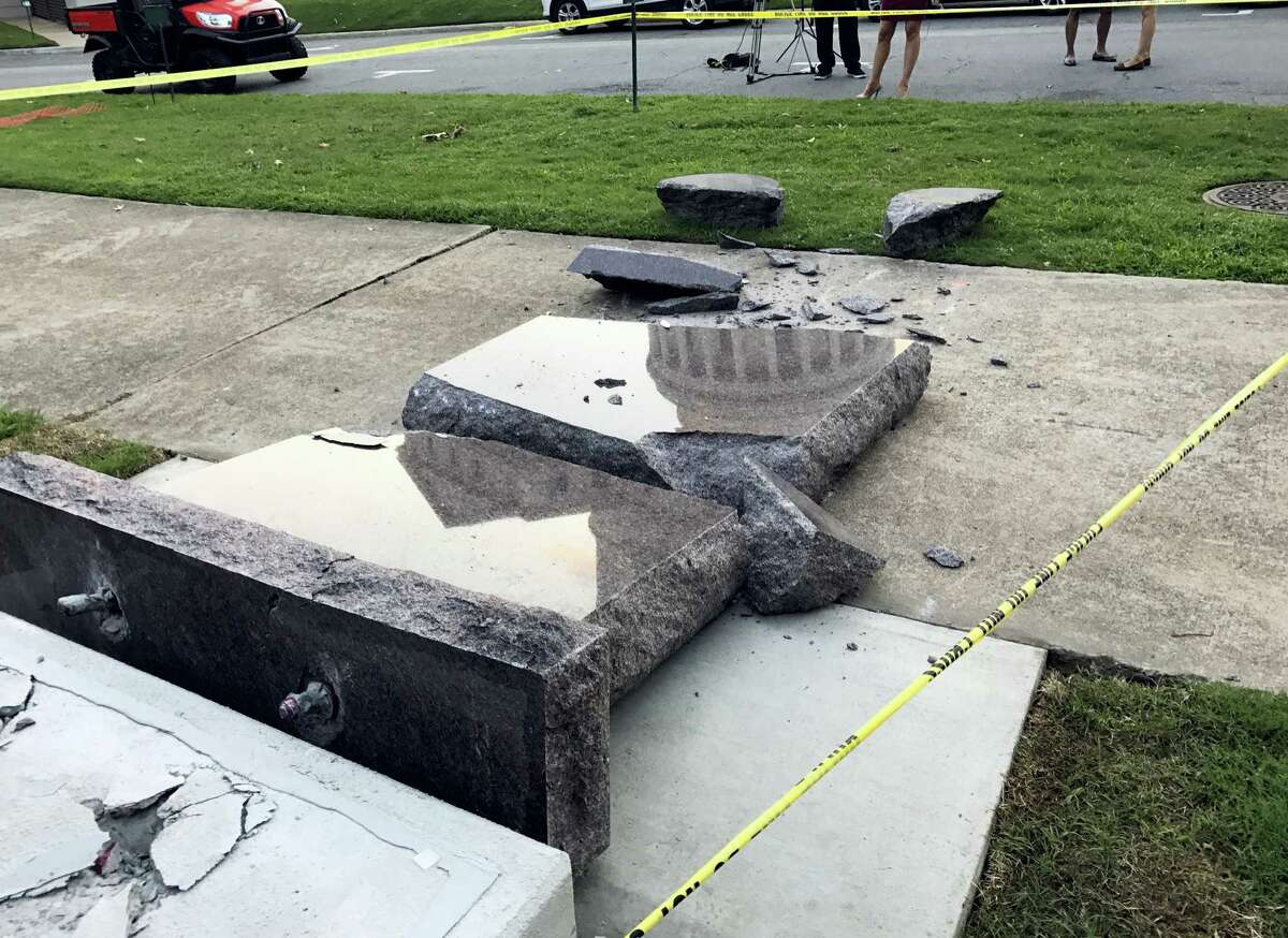 The new Ten Commandments monument outside the state Capitol in Little Rock, Ark., is blocked off Wednesday morning, June 28, 2017, after someone crashed into it with a vehicle, less than 24 hours after the privately funded monument was installed on the Capitol grounds. Authorities arrested a male suspect.