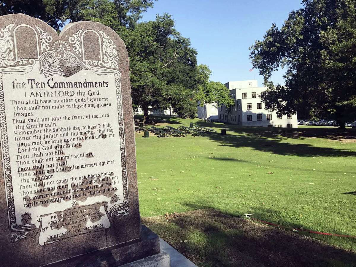 A 6-foot-tall, privately funded Ten Commandments monument is seen on the Arkansas Capitol grounds Tuesday, June 27, 2017, in Little Rock after it was installed by workers two years after lawmakers approved a measure allowing the statue on state property.