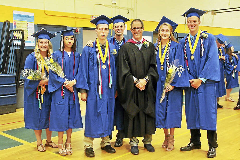 The Gilbert School's principal, Alan Strauss, joined students for photos at graduation ceremonies on June 23. Strauss resigned from his position this week to take a job in Massachusetts. Photo: Anita Garnett / Hearst Connecticut Media