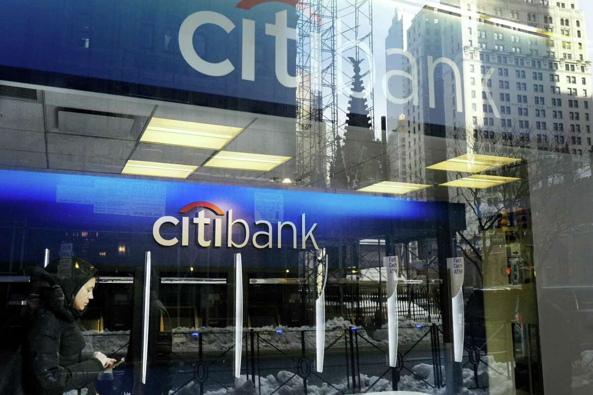 In this Thursday, March 16, 2017, file photo, a customer enters a Citibank branch, in New York. On Wednesday, June 28, 2017, the Federal Reserve gave the green light to all 34 of the biggest banks in the U.S. to raise their dividends and buy back shares, judging their financial foundations sturdy enough to withstand a major economic downturn. Those allowed to raise dividends or repurchase shares include the four biggest U.S. banks: JPMorgan Chase, Bank of America, Citigroup and Wells Fargo.