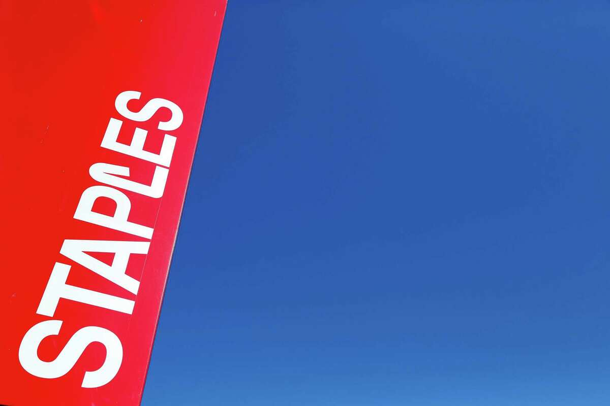 This Tuesday, March 1, 2016, file photo, shows a Staples store sign in New York. On Wednesday, June 28, 2017, private equity firm Sycamore announced it is buying office supplies chain Staples for $6.9 billion.