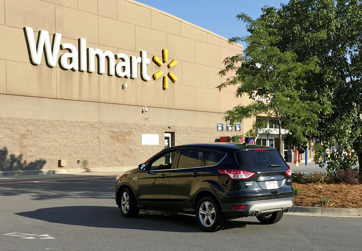 A motorist drives through a Walmart parking lot in west Little Rock, Ark., Wednesday, June 28, 2017. The company was hosting hundreds of potential vendors at its Bentonville headquarters on Wednesday, searching for products to someday stock on store shelves.