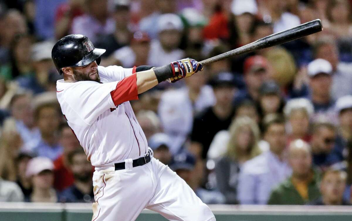 Boston Red Sox's Dustin Pedroia follows through on an RBI single during the seventh inning of a baseball game against the Minnesota Twins at Fenway Park in Boston, Monday.