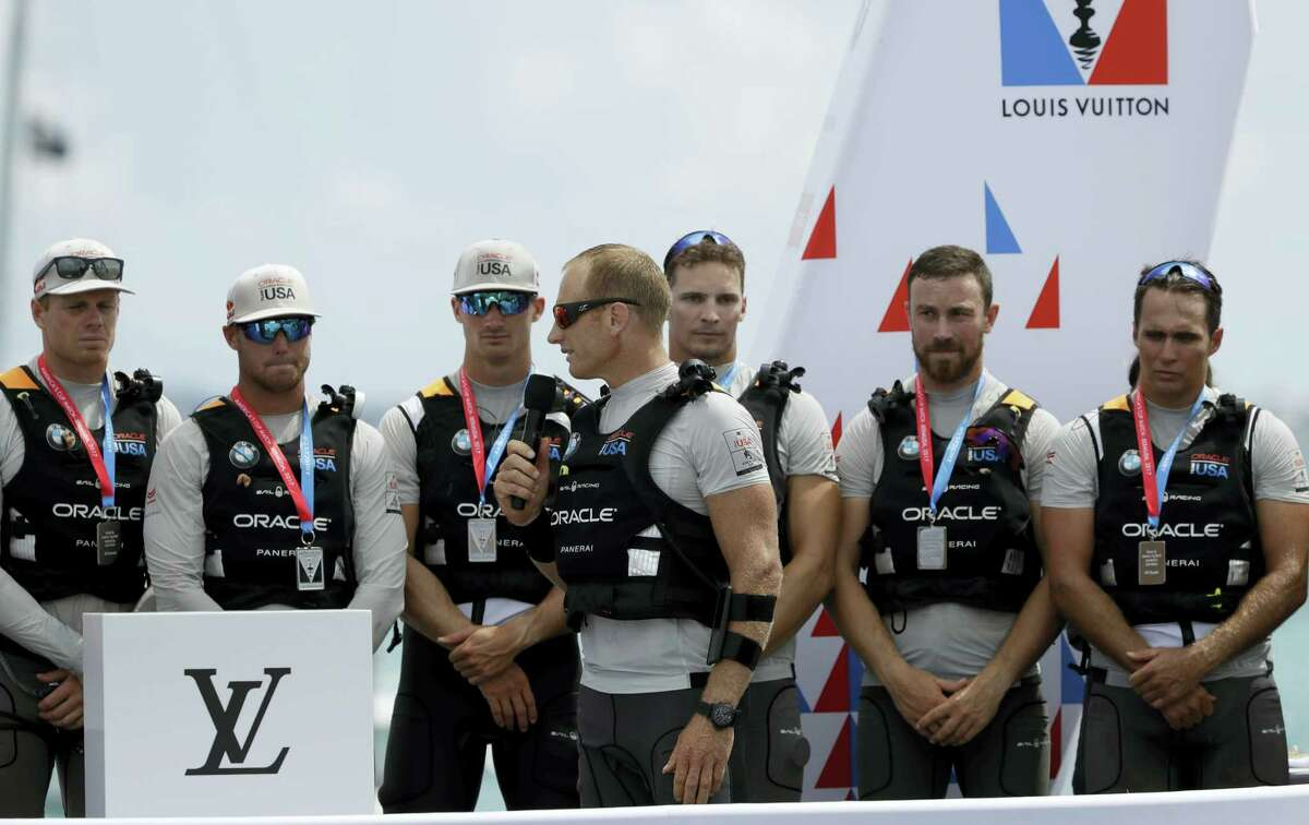 Oracle Team USA skipper Jimmy Spithill address his crew and fans following his teams loss to Emirates Team New Zealand in the America's Cup sailing competition Monday, in Hamilton, Bermuda.