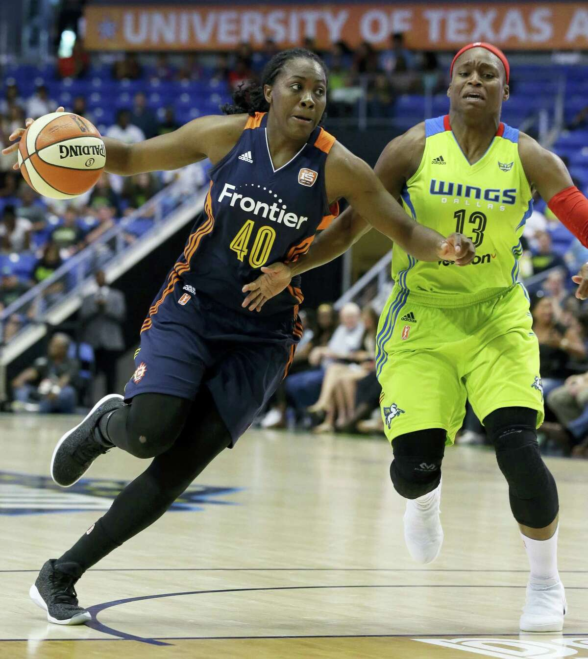 Connecticut Sun guard Shekinna Stricklen (40) drives against Dallas Wings guard Karima Christmas-Kelly (13) during the second half of a WNBA basketball game in Arlington, Texas on June 25, 2017.