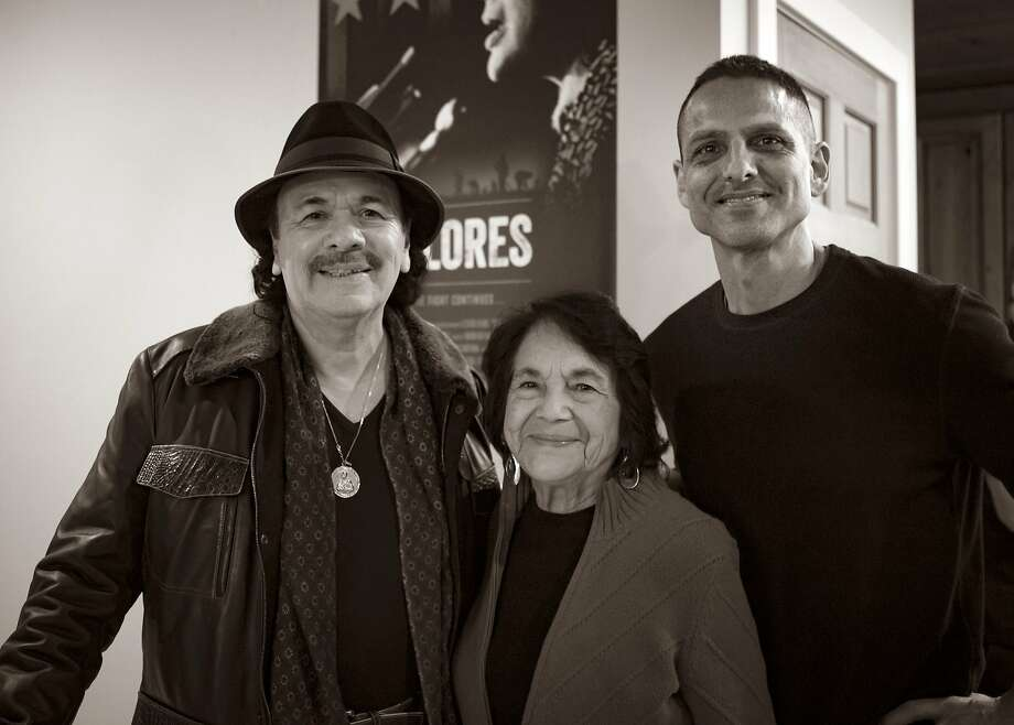 "Executive producer Carlos Santana (left), subject Dolores Huerta, and director Peter Bratt at the opening of the documentary ""Dolores."" Photo: Rafael Rodriguez"