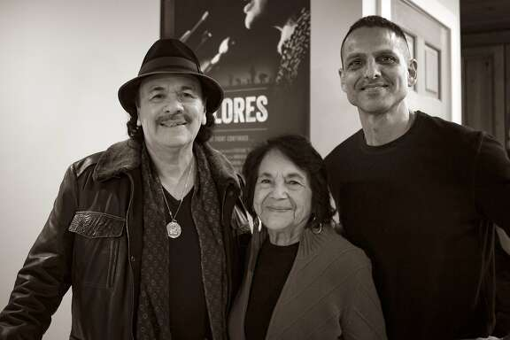 """L-R: Executive producer Carlos Santana, subject Dolores Huerta, and director Peter Bratt of the documentary """"Dolores,"""" opening at Bay Area theaters on Friday, June 8. Photo courtesy of Rafael Rodriguez"""