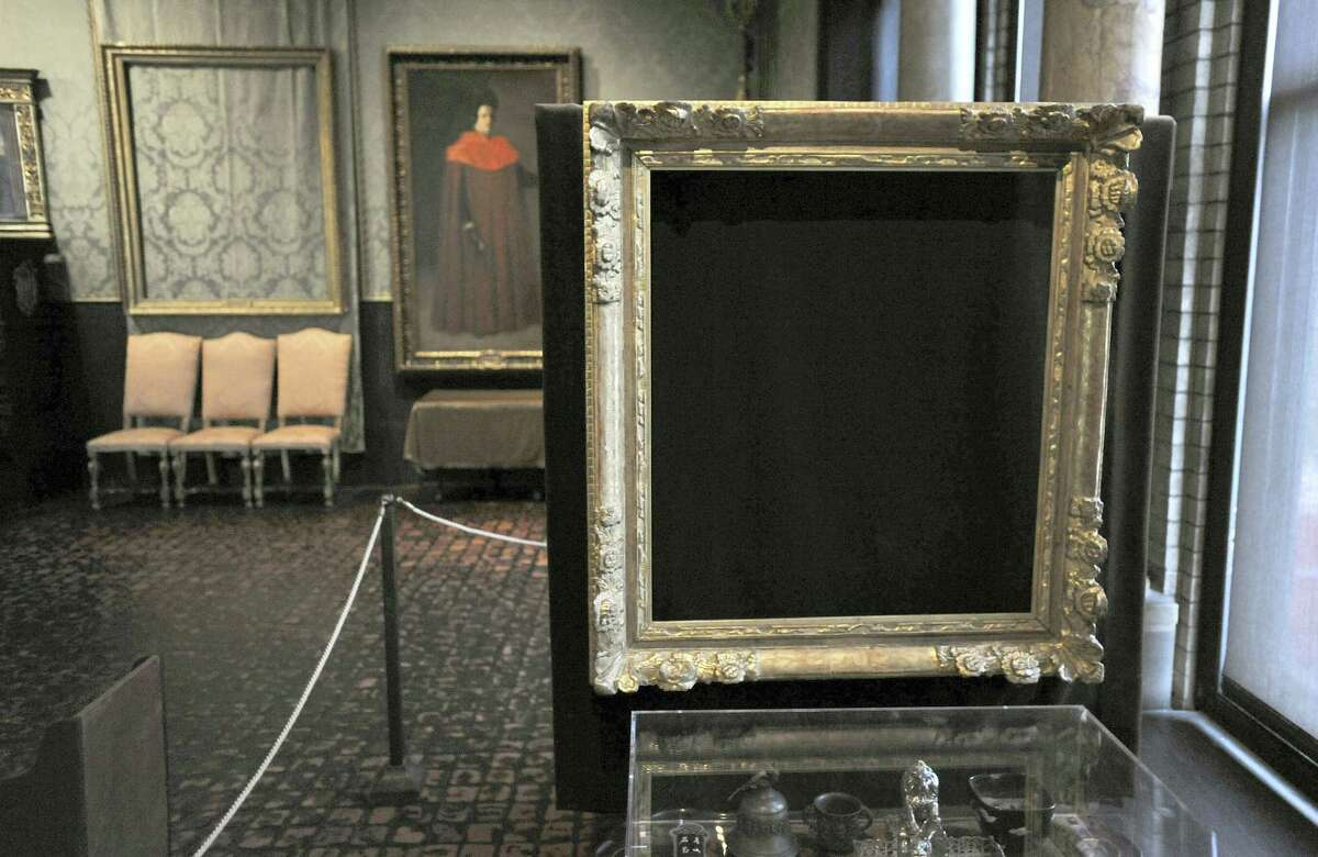"""In this March 11, 2010, file photo, empty frames from which thieves took """"Storm on the Sea of Galilee,"""" left background, by Rembrandt and """"The Concert,"""" right foreground, by Vermeer, remain on display at the Isabella Stewart Gardner Museum in Boston. A Dutch sleuth has his sights set on what he calls the """"Holy Grail"""" of stolen art: A collection worth $500 million snatched in 1990 in the largest art heist in U.S. history from Boston'Äôs Isabella Stewart Gardner Museum."""