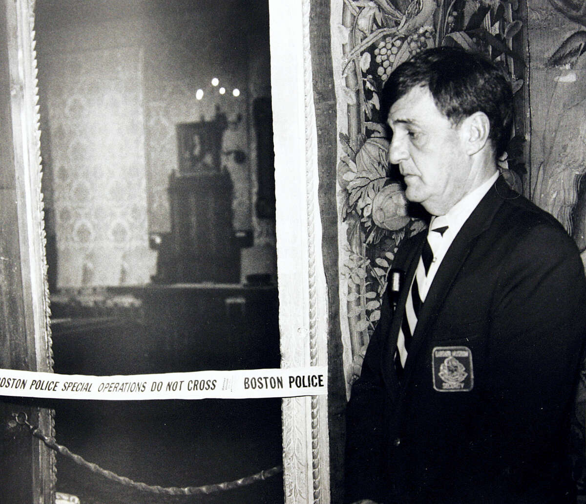 """In this March 21, 1990, file photo, a security guard stands outside the Dutch Room of the Isabella Stewart Gardner Museum in Boston, where robbers stole more than a dozen works of art by Rembrandt, Vermeer, Degas, Manet and others, in an early morning robbery March 18, 1990. A Dutch sleuth has his sights set on what he calls the """"Holy Grail"""" of stolen art: A collection worth $500 million snatched in 1990 is the largest art heist in U.S. history from Boston's Isabella Stewart Gardner Museum."""