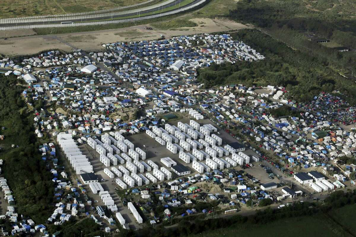 In this Monday, Oct. 17, 2016, file photo showing an aerial view of a makeshift migrant camp near Calais, France.