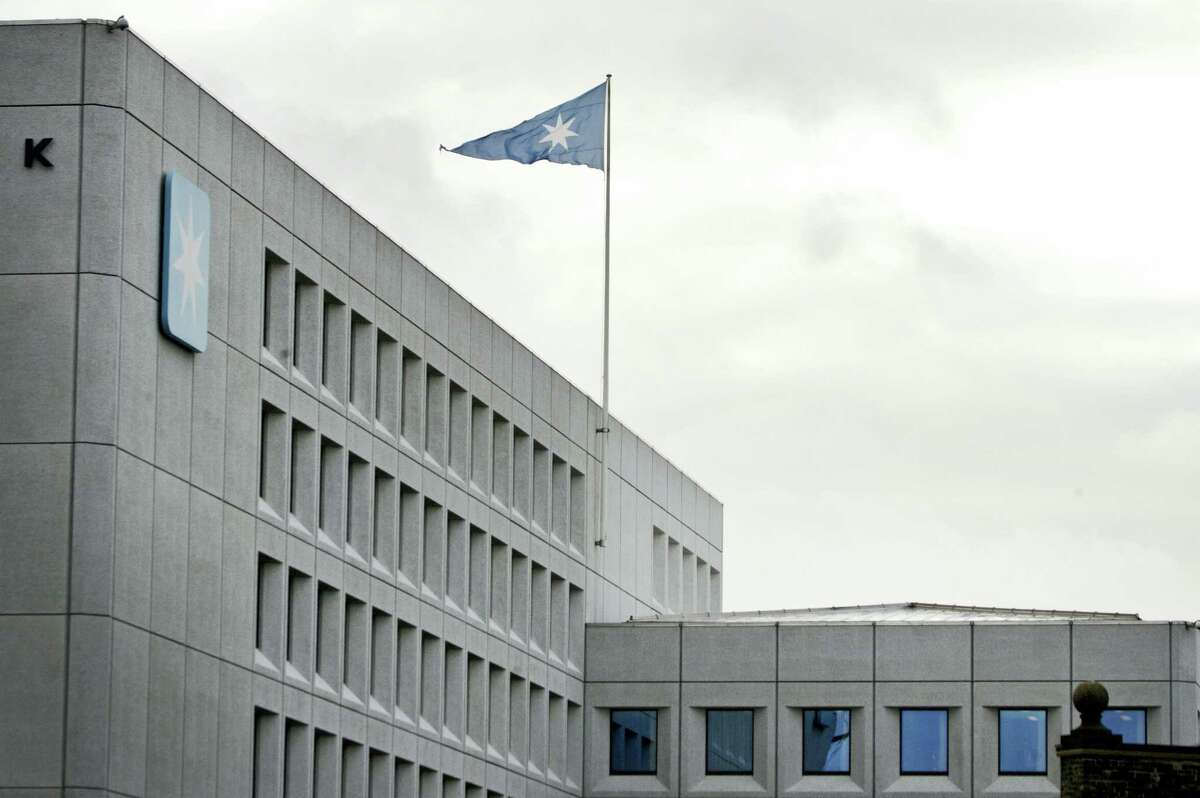 In this in this Jan. 1, 2008, file photo a flag files over the headquarters of shipping company A.P. Moller-Maersk in Copenhagen, Denmark. Hackers Tuesday June 27, 2017, caused widespread disruption across Europe, hitting Ukraine especially hard. Russia's Rosneft energy company also reported falling victim to hacking, as did shipping company A.P. Moller-Maersk, which said every branch of its business was affected.