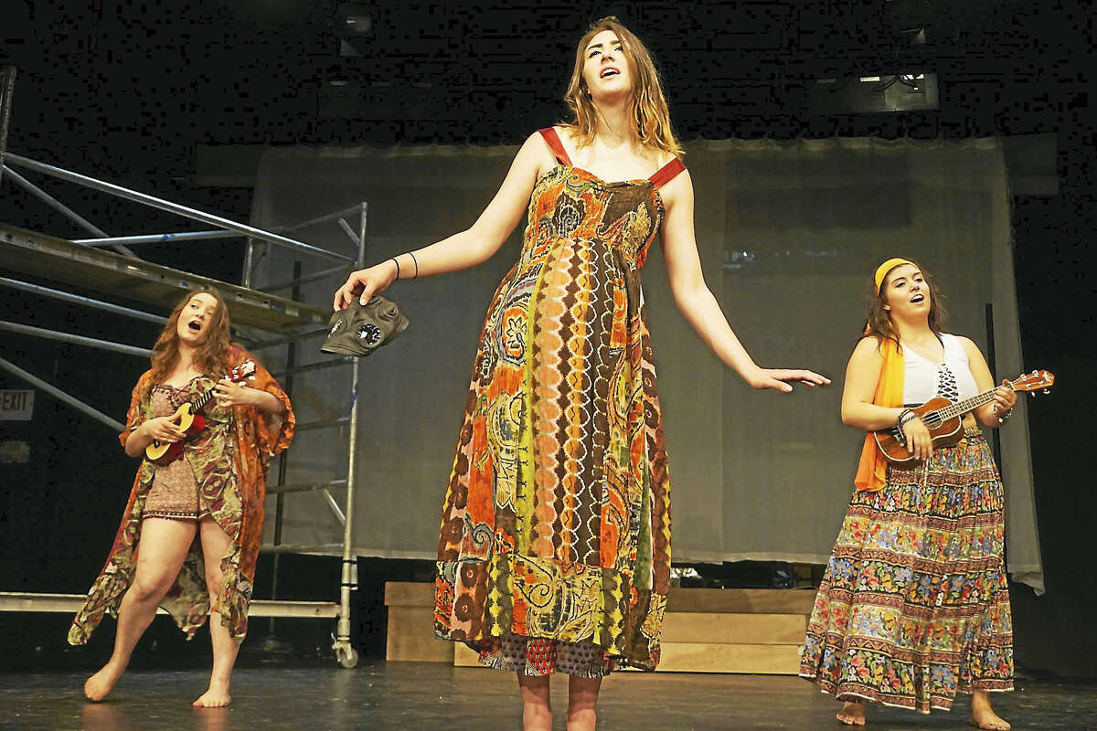 "Members of the cast of ""Hair"" rehearse for the show's opening on Friday night in Sherman. The show runs through July 29."