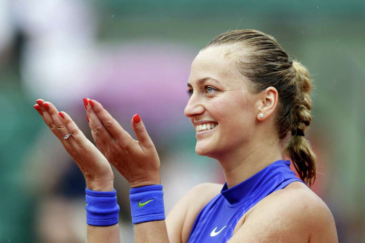 Petra Kvitova of the Czech Republic thanks the crowd after defeating Julia Boserup, of the U.S, in their first round match of the French Open tennis tournament at the Roland Garros stadium on May 28, 2017 in Paris.