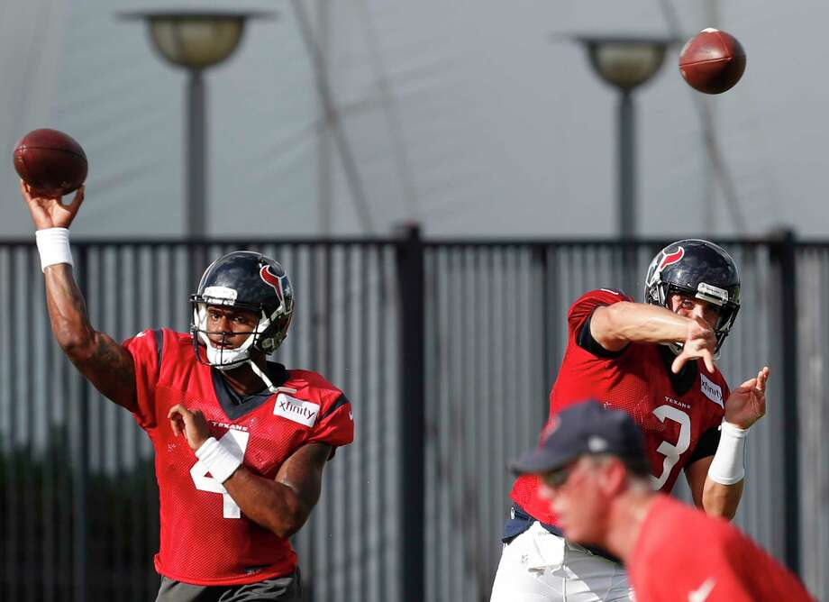 Houston Texans quarterbacks Deshaun Watson (4) and  Tom Savage (3) throw passes side by side during training camp at The Methodist Training Center on Tuesday, Aug. 22, 2017, in Houston. ( Brett Coomer / Houston Chronicle ) Photo: Brett Coomer, Staff / © 2017 Houston Chronicle}