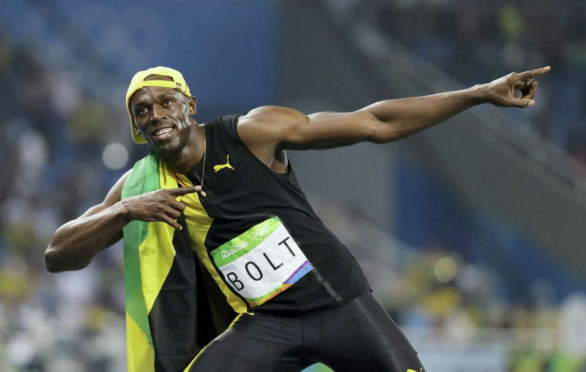 Jamaica's Usain Bolt celebrates winning the men's 100-meter final during the athletics competitions of the 2016 Summer Olympics at the Olympic stadium in Rio de Janeiro, Brazil on Aug. 14, 2016.
