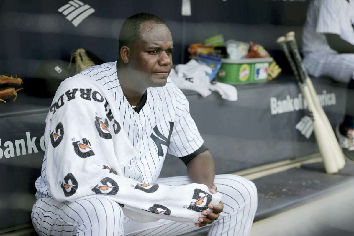 Yankees starting pitcher Michael Pineda sits in the dugout during the first inning Sunday.