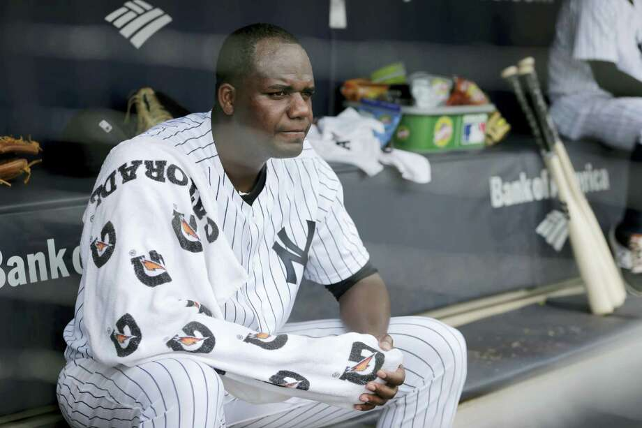 Yankees starting pitcher Michael Pineda sits in the dugout during the first inning Sunday. Photo: Seth Wenig — The Associated Press  / Copyright 2017 The Associated Press. All rights reserved.