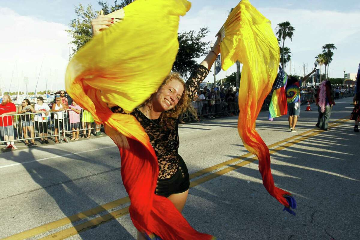 Whitney Householder dances during the gay pride parade in St. Petersburg, Fla. on June 24, 2017.