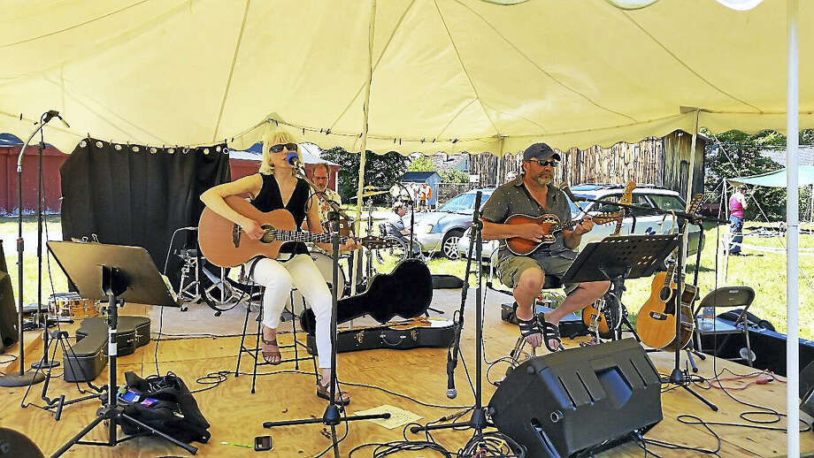 """The folk duo Martha and Andy sung such cover songs such as Peter, Paul and Mary's """"Leaving on a Jet Plane"""" and Johnny Cash and June Carter Cash's duet """"Jackson"""" (among 12 local musical acts total) at the first-ever Still River Music Festival at the Riverton Fairgrounds in Riverton on Saturday afternoon. Photo: Photo BY N.f. AMBERY"""