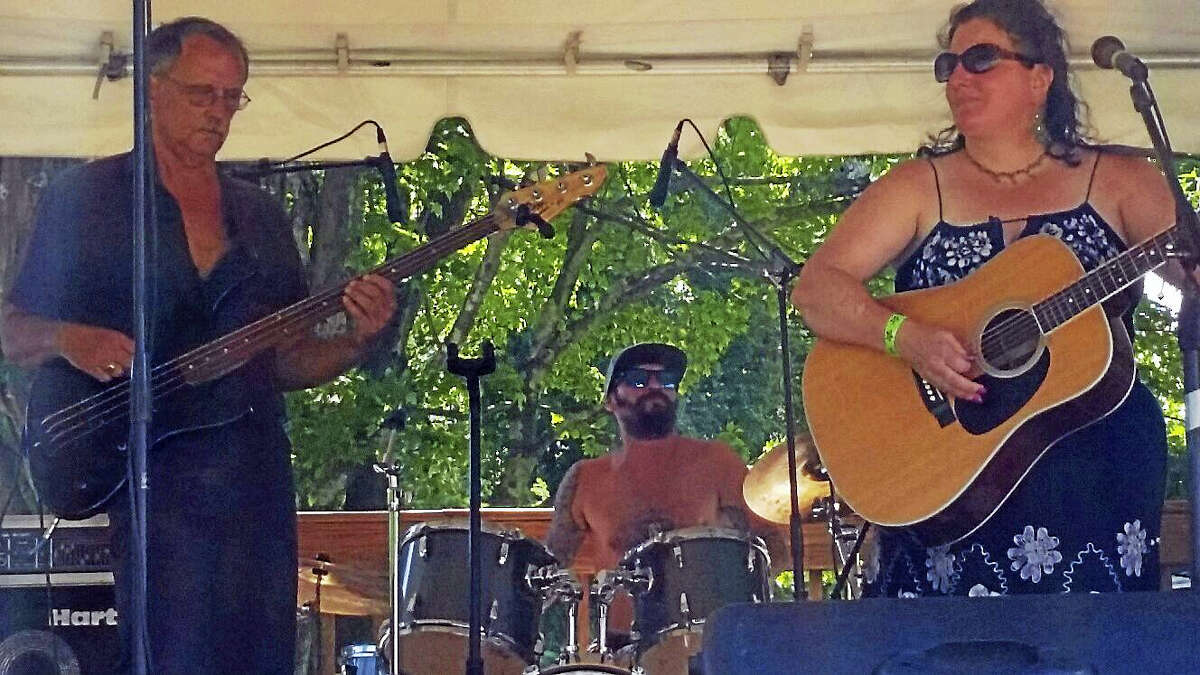 The band Con Coyote Doty and Moses Bones played blues-influenced rock to a bandstand audience (among 12 musical acts total) at the first-ever Still River Music Festival at the Riverton Fairgrounds in Riverton on Saturday afternoon.