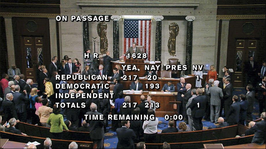 House Television via the associated press  In this image provided by House Television, the final total on the vote on the Republicans health care bill is displayed at the Capitol in Washington. Photo: AP / House Television
