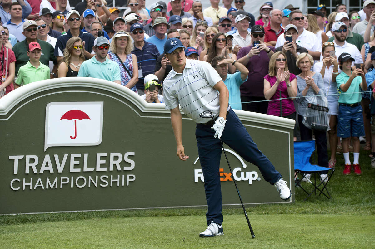 Jordan Spieth watches his drive from the first tee at the Travelers Championship on Wednesday.