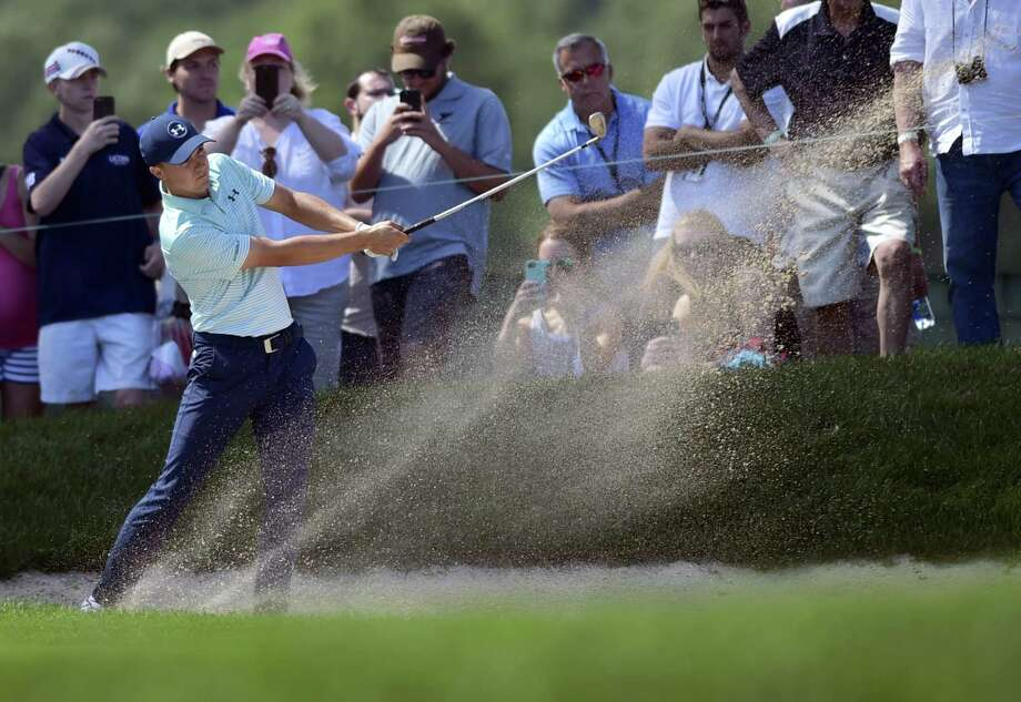 Jordan Spieth hits his second shot on the ninth hole during the third round of the Travelers Championship on Saturday in Cromwell. Photo: Brad Horrigan — Hartford Courant Via AP  / Hartford Courant