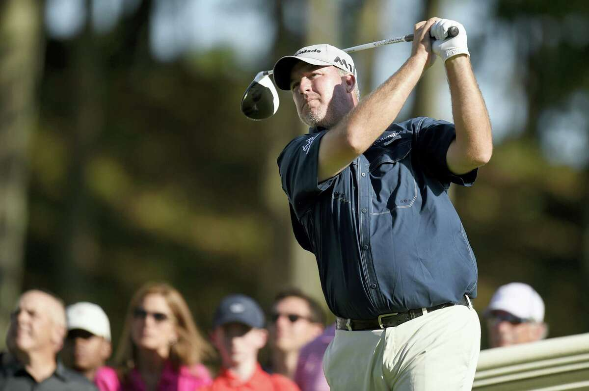 Boo Weekley watches his tee shot on the 18th hole during the third round of the Travelers Championship on Saturday.