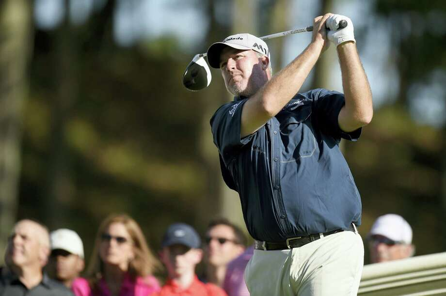Boo Weekley watches his tee shot on the 18th hole during the third round of the Travelers Championship on Saturday. Photo: John Woike — Hartford Courant Via AP  / Hartford Courant