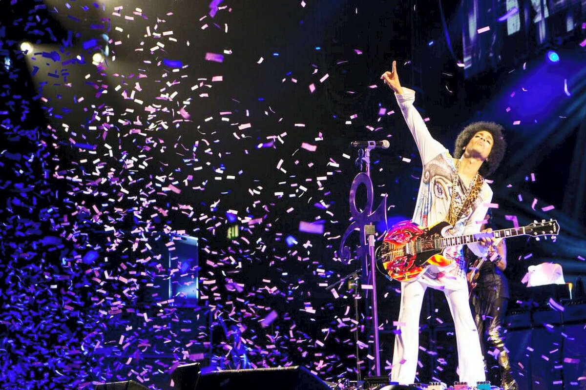 In this 2014 photo, Prince performs in Birmingham, England.